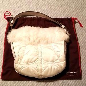 White satin Coach fur bag